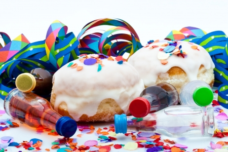 donuts for a party isolated on white background with air streamers, noisemaker and liqueur