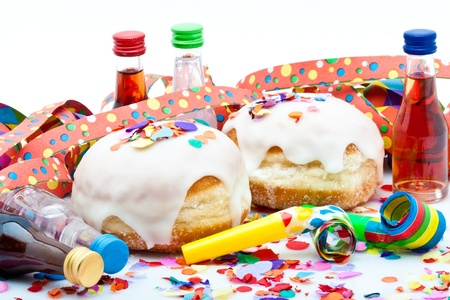 donuts for a party isolated on white background with air streamers, noisemaker, confetti and liqueur