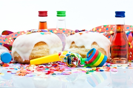 noisemaker: donuts for a party isolated on white background with air streamers, noisemaker, confetti and liqueur