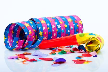 colorfull noisemakers for a party isolated on white background with air streamers and confetti photo