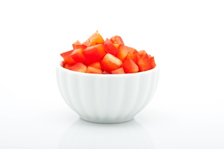 closeup of fresh red peppers in bowl isolated on white background