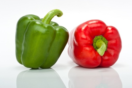 closesup of red and green pepper isolated on white background Stock Photo