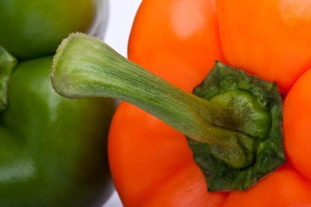 closesup of orange and green pepper isolated on white background Stock Photo