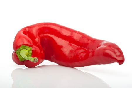 closeup of two red hot peppers isolated on white background