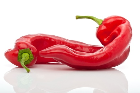 closeup of two red hot peppers isolated on white background photo