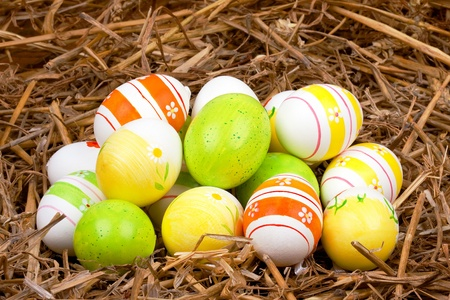 closeup of colorful painted easter eggs hidden in a nest of straw Stock Photo - 17016901