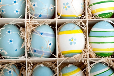 closeup of assorted colorful painted easter eggs in a wodden box photo