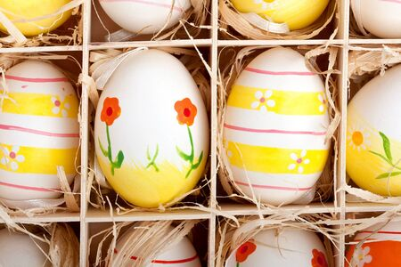 closeup of assorted colorful painted easter eggs in a wodden box Stock Photo - 17164535