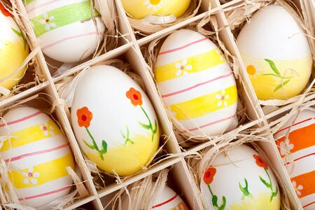 closeup of assorted colorful painted easter eggs in a wodden box Stock Photo - 17164523