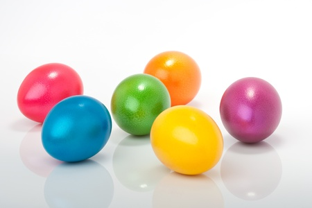 lot of colorful orange, violett, blue, red, yellow, purple easter eggs isolated against white background