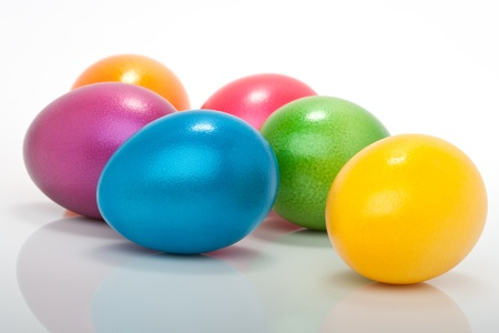 violett: lot of colorful orange, violett, blue, red, yellow, purple easter eggs isolated against white background