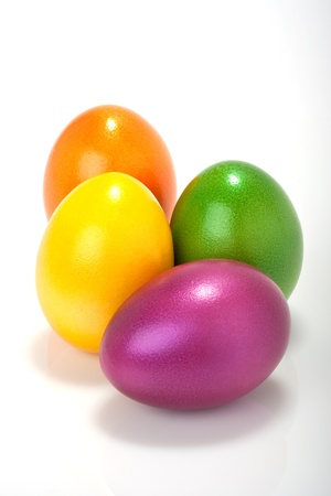 lot of colorful orange, violett, yellow, purple easter eggs isolated against white background