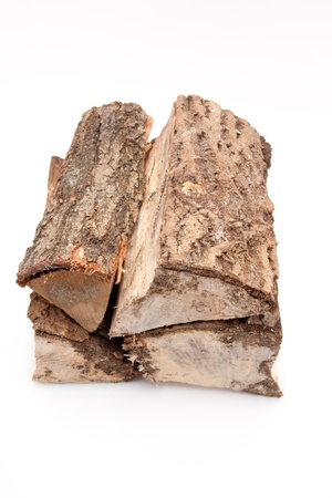 closeup of a stack of firewood isolated on white background