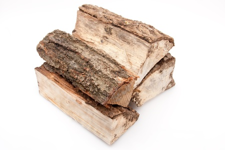 inexhaustible: closeup of a stack of firewood isolated on white background