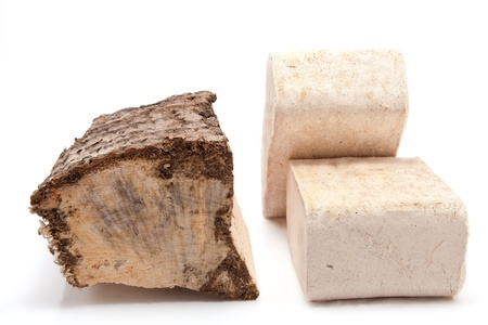 closeup of a piece of firewood and a wooden briquette isolated on white background Stock Photo - 17285185