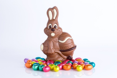 Easter bunny made of chocolate with colorful easter eggs isolated on a white background Stock Photo