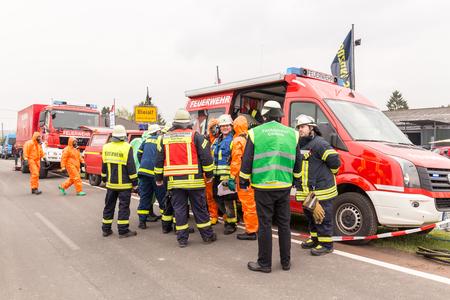 Fireman demonstrate how to handle hazardous material - public demonstration May 2017 in Bleialf, Eifel, Rheinland-Pfalz, Germany, Europe, EU Редакционное
