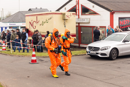 Fireman demonstrate how to handle hazardous material - public demonstration May 2017 in Bleialf, Eifel, Rheinland-Pfalz, Germany, Europe, EU Editorial