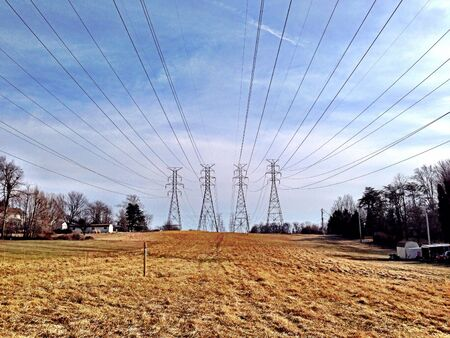power lines: Power lines over a soon-to-be built development in Carney, MD. Stock Photo