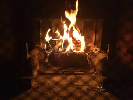 A roaring fire in the fireplace. Фото со стока