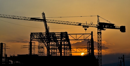 silhouette crane building and sunset of Southeast Asia photo