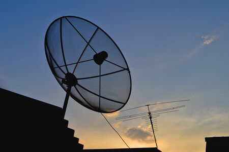 Satellite Dish and Antenna TV on Sunset Time Stock Photo - 14783641
