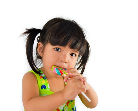cute asian baby girl and big lollipop of thailand southeast asia photo