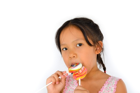 cute broken teeth girl and lollypop of thailand southeast asia