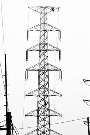silhouette electrician working on electricity tower post Stock Photo - 15544507