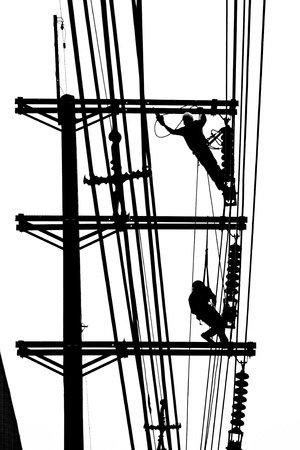 silhouette electrician working on electricity post Stock Photo - 15544425