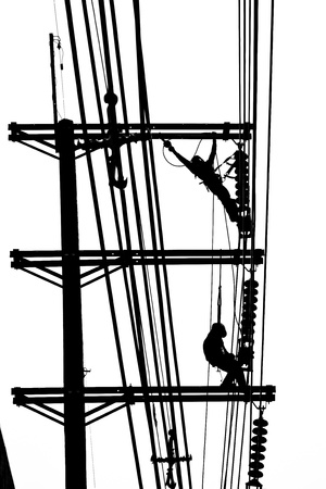 silhouette electrician working on electricity post Stock Photo - 15544430
