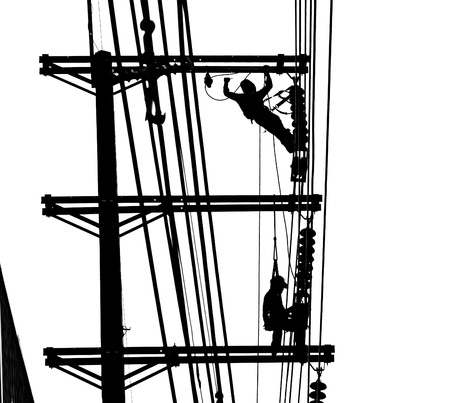 silhouette electrician working on electricity post photo