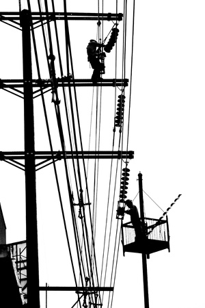 capability: silhouette electrician working on electricity post