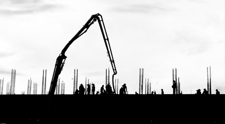 silhouette labor working on building Banque d'images