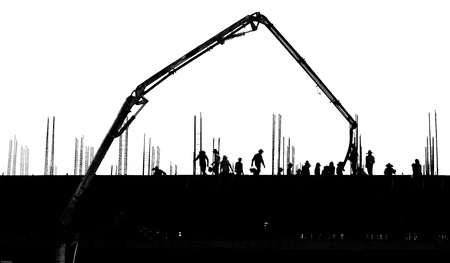silhouette labor working on building photo