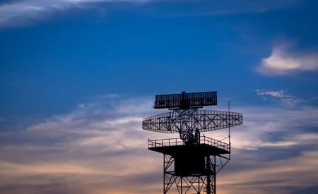 silhouette radar tower plane photo