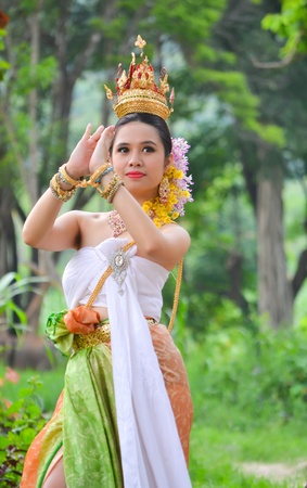 an obeisance: asian women in traditional costume of thailand southeast asia