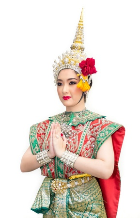 an obeisance: beautiful asian women in traditional costume of thailand southeast asia