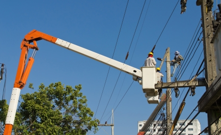electrician working repair electricity post on cabin and blue sky Stock Photo - 17338347