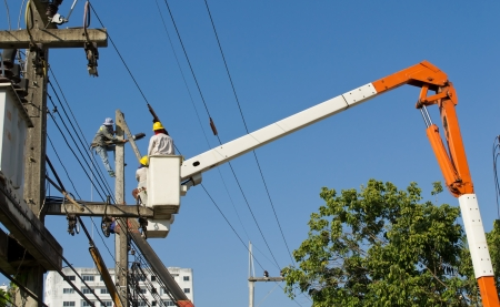 electrician working repair electricity post on cabin and blue sky Stock Photo - 17338349