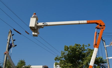 electrician working repair electricity post on cabin and blue sky Stock Photo - 17338346