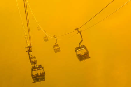 Silhouette Cable Cars in fog Stock Photo