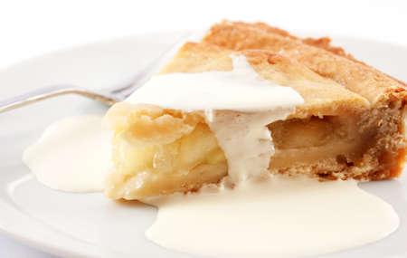 Slice of apple pie with cream photo