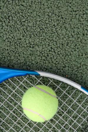 raquet: tennis ball lying on racquet on tennis court