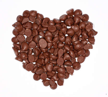 chocolate chips: Heart shape made out of milk chocolate chips Stock Photo