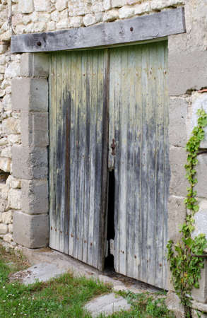 bad condition: Old wooden doors to a barn in bad condition Stock Photo
