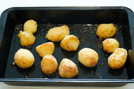 roast potatoes: Roast potatoes in a baking tray