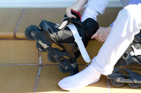 putting on: Putting on roller blades