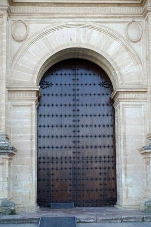 large doors: Old wooden entrance door of the  Colegiata de Santa Maria la Mayor   in Antequera