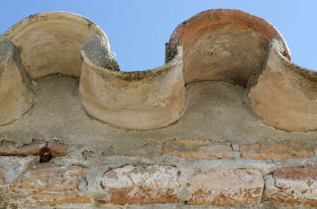 spanish tile: Close up of edge of curved Spanish roof tile